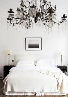 Eclectic modern black and white bedroom decor featuring a dramatic chandelier - Neutral Home Decor & Ideas - by Rose Uniacke via Remodelista Dream Bedroom, Home Bedroom, Bedroom Decor, Bedroom Ideas, Bedroom Girls, Bedroom Inspo, Bedroom Curtains, Master Bedrooms, Bedroom Designs
