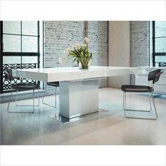 "Astor Dining Table in White Lacquer  by  Modloft -  The Astor extendable modern dining table is the perfect solution for your dining. It easily transforms from a medium size (71"" - seats up to 8) to an extra large size (94"" - seats up to 10) table. Contemporary white lacquer adds a chic note."