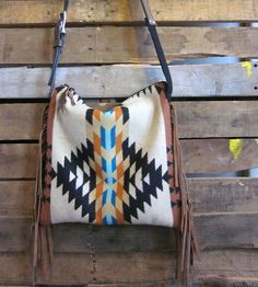 Leather & Wool Teal Fringed Bag by Mercy Grey Design Co. on Scoutmob Shoppe. This brown and teal geometric pattern purse looks as good on a hike as in does on a trip to the boutique.