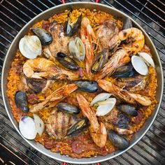 With a few tweaks that harness the power of a backyard grill, you can make the perfect paella—smoky, savory and rich with crispy soccorat. Here's how.