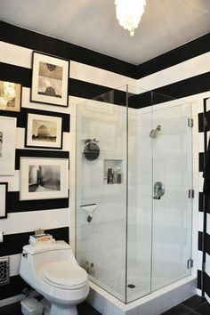 black+white stripes + gallery walls in a bathroom! swoon!