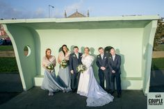 The Bridal Party on the Clontarf Seafront. Weddings at Tulfarris Hotel Photographed by Couple Photography.