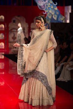 Long blouse Indian wedding lehenga with black border by Suneet Varma. More here: http://www.indianweddingsite.com/bmw-india-bridal-fashion-week-ibfw-2014-suneet-varma/
