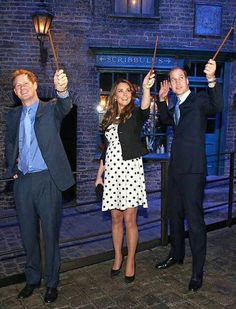 A duchess and two princes, just showing off their wands.