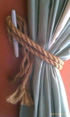 I WILL do this somewhere in the new house! Ship cleats for window treatment hooks, and then tied with rope/line