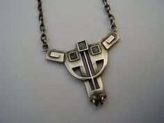 are antique Jugendstil silver necklace. The necklace was made in Pforzheim, Germany, around 1902. The pendant is marked on the reverse for 800 out of 1000 parts silver. $350