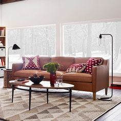 Những mẹo trang trí phòng khách thêm xinh cùng sofa da thật tphcm