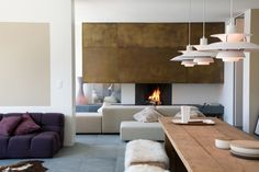 """Engadina Modern is a project designed by Carlo Donati Studio. Completed in 2008, this apartment is located in Pontresina, a small city in the canton of Graubünden in Switzerland.          Engadina Modern by Carlo Donati Studio: """"The aim of the project was to create a dialogue between the minimalist approach of the design, pure spaces and lines with the typically warm atmosphere of Engadine-style houses in Pontresina. We wanted to combine sophisticated design with ironic, decorative motifs…"""