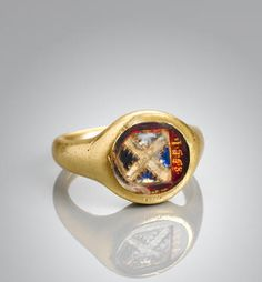 A fine and rare Elizabethan gold and foiled crystal armorial signet ring, dated 1568