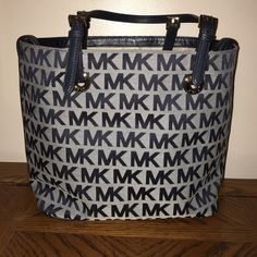 Michael Kors tote Brand new without tags Michael Kors tote. Blue trim. Michael Kors Bags Shoulder Bags