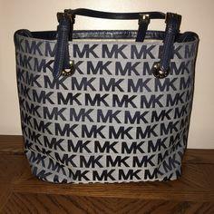 "Michael Kors Medium Jet Set Shoulder Tote Handbag ♨️ AWESOME PRICE ♨️ NWOT MK Medium Jet Set Shoulder Tote Handbag. Light Blue Canvas with Dark Blue MK Logo all over Tote, leather trim with 10"" drop double leather straps with Buckles, 1 zip pocket, 4 slip pockets and hardware on bottom. 14.5/11""L x 10.5""H x 6""D Michael Kors Bags Shoulder Bags"