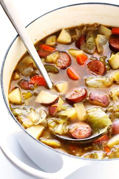 This Cabbage, Sausage and Potato Soup recipe is hearty and comforting, easy to make, and so savory and delicious. My kind of cabbage soup!   gimmesomeoven.com (Gluten-Free / Dairy-Free)