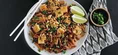 A vegan take on a Thai classic. Pad Thai — a stir-fried noodle dish — is made here with carrots, shallots, and garlic. The veggies are quickly stir-fried, then cooked in an umami-rich pad Thai sauce (featuring tamari, tamarind paste, lime, and coconut nectar). It's all tossed with brown-rice noodles and seared tofu. Chopped peanuts add a gentle crunch on top.