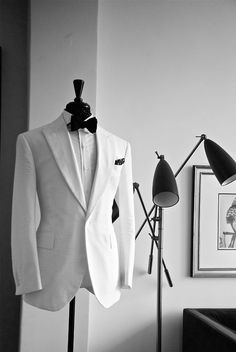 White suit, black bow-tie,