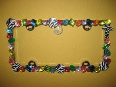Chunky Multi-Colored License Plate with Zebra & Rhinestone Peace Sign. $40.00, via Etsy .. this would be cute to use as a picture frame for kids' walls