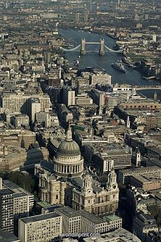 Aerial view of St. Pauls Cathedral, Tower Bridge and the River Thames, London UK