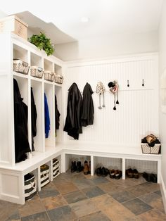mudroom organization with cubbies and coat hooks