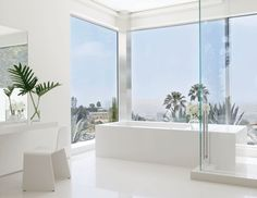 These beautiful white bathrooms are filled with great ideas for devising a minimal space with big impact