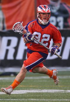 Brice Queener #92 of the Hamilton Nationals runs with the ball during Major League Lacrosse game action against the Charlotte Hounds on August 4, 2012 at Ron Joyce Stadium in Hamilton, Ontario, Canada. (Photo by Tom Szczerbowski/Getty Images)
