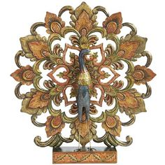 Our Balinese Peacock is a peacock like no other. Hand-carved from albasia wood, its alluring tail displays red, orange and green hues that have been lightly painted with a bit of golden iridescence. Place him to roost on a mantel, in an office or on a shelf, and all eyes will be drawn to his flamboyant fan.