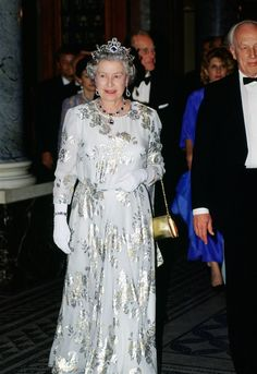 Weight Watchers Recipes Discover Fit for a queen: See how Queen Elizabeths royal style has evolved Queen Elizabeth attends the opera in a silver patterned dress during her first official visit to Hungary in May Royal Queen, Royal Princess, King Queen, Princess Diana, Rey George, King George, Queen And Prince Phillip, Prince Philip, Princess Dress Up