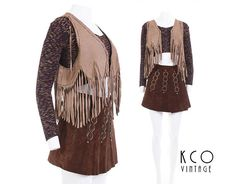 70s vintage suede fringe crop top vest. • Beige suede leather with tiny metal chain laced along edges. • The ends dangle loosely at the bottom at on the top of shoulders. • Cropped length. • Appears to have had a central chain or closure that is missing, two tiny holes remain • A few rusty colored stains in the back, see pic #3. • One tarnished spot in the front likely from the chain sitting on it during storage. • Vintage suede and leather wasnt chemically treated like suede nowadays is, so…