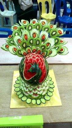 Carved-out Peacock from watermelon, combined with other fruits and veggie for the tail.
