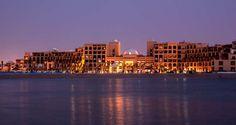 Hilton Ras Al Khaimah Resort & Spa-exterior At Dusk Beach Resorts, Hotels And Resorts, Ras Al Khaimah, Arabian Peninsula, Beautiful Places In The World, Resort Spa, New York Skyline, Dubai, Places To Visit