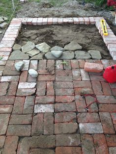 reclaimed bricks and river stones = our new RV patio