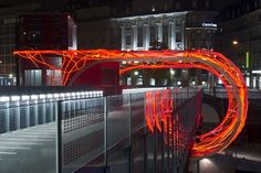 Design studio Allegory created Flux Cocoon, a red LED knot that wraps around a pedestrian bridge in Lausanne, Switzerland. Studios Architecture, Eco Architecture, Contemporary Architecture, Lausanne, Neon Lighting, Lighting Design, Outdoor Lighting, Residential Building Design, Red Led Lights