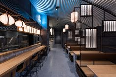 after the big success of the nozomi sushi bar, creative consultancy masquespacio has completed the design of the hikari yakitori bar in valencia.
