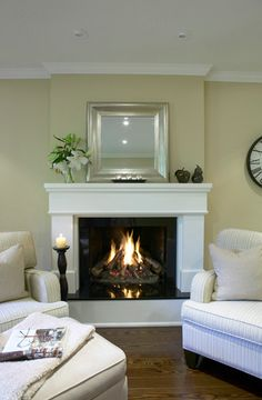 Mirror over the fireplace is nice. Crown Molding.