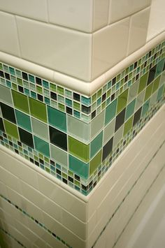 Combination of glass tile and subway tile.. Pretty. .BUT all those grout lines would drive me crazy