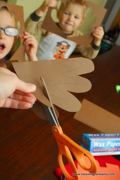 Thanksgiving is quickly approaching, and this Thanksgiving footprint turkey craft with tissue paper stained glass wings captures your child's footprint Tissue Paper Crafts, Wax Paper, Turkey Handprint, Paper Feathers, Turkey Craft, Kids Up, Paper Frames, Thanksgiving Crafts