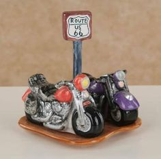 """Route 66 Ceramic Motorcyle Salt & Pepper Shakers with Base by Popular Creations. $24.99. Motorcycles with Route 66 Sign base. measure approx 6 inches high x 5 inches wide. Made of Ceramic. 3 Pc. Set. Route US66 Red and Black Motorcycle Salt and Pepper Shaker Set  These glazed ceramic Salt and Pepper Shakers will liven up any meal!  A must have for the motorcycle enthusiast  3 Piece set includes red and black motorcycles on base with Route US66 Sign  Dimensions: 4 1/2""""L by 4 1/2""""H"""