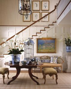 What to Hang in a Two-Story Foyer Ordinary wall art is often too small in two-story rooms like foyers; solve this decorating dilemma with one of these large-scale wall art ideas.: Hang a Gallery Wall Foyer Decorating, Interior Decorating, Interior Design, Decorating Ideas, Decorating Bookshelves, Interior Architecture, Design Entrée, House Design, Design Ideas
