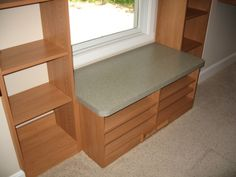 Master Bedroom Walk-In Closet: Custom Wood Shelving, Window Seat Bench