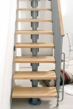 Arke Kompact Straight Flight Stair Kit -- Available in 2 width sizes: 740mm & 890mm. A standard kit comes with 12 treads (13 risers) and suits a floor height up to 3030mm. Heights up to 3730mm can be achieved with the use of additional tread kits. The metal-work is available in 3 colours: Black, White & Grey. The solid beech treads are available in a light or dark finish. The unit is supplied with a railing to one side of the stair. # From £1,425.00 + VAT