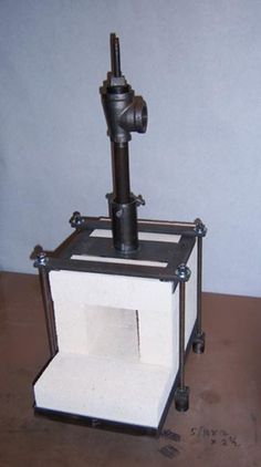 Firebrick Gas Forge by Larry Zoeller -- Homemade firebrick gas forge constructed from angle iron, flat bar, pipe, and threaded rod. Chamber volume is 144 cubic inches. http://www.homemadetools.net/homemade-firebrick-gas-forge