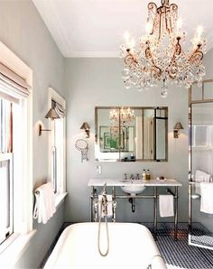 Gray walls and a stunning chandelier! We couldn't ask for more in the bath.