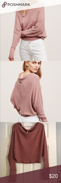 Free People Mercury tee Gently worn luxurious cotton tee. Fabric is intentionally made for that worn-in look. Dolman sleeves. Boat neck. Slightly cropped. I wear a size 10-12 and this fits me fine. Color is best represented by photos of actual top not stock photos. Free People Tops