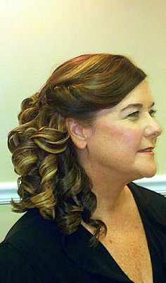 Side swept flat iron curls,  pinned. Mother of the bride, bridesmaid hair style.