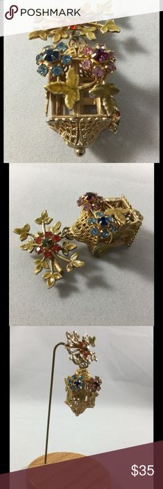 Vintage Red Flower/Leaves with Dangle Cage Brooch Vintage gold tone red rhinestone flower and leaves with a dangle three dimensional bird cage.  The cage is adorned with rhinestone flowers and leaves.  Too cute! unknown Jewelry Brooches
