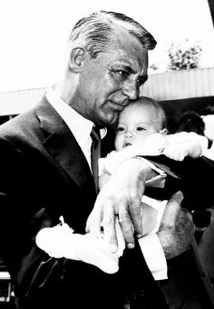 Cary Grant pictured with his daughter Jennifer in England, 1966