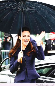 Kate in a navy suit