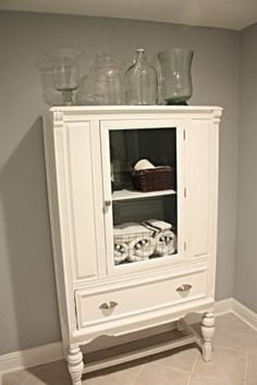 Lovely! Would love to find an antique armoire to refinish for storage in our Masterbath.  ala Bower Power.