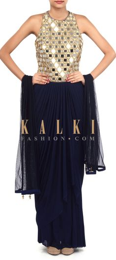 Buy Online from the link below. We ship worldwide (Free Shipping over US$100). Product SKU - 305571.Product Link - http://www.kalkifashion.com/navy-blue-suit-adorn-in-mirror-and-zari-embroidery-only-on-kalki.html