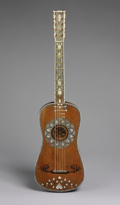 Attributed to Matteo Sellas (Italian, ca. 1612–1652). This five-course guitar has a vaulted back with scalloped snakewood ribs and ivory spacers. The back of the neck is inlaid in a checkerboard pattern made of bone and snakewood squares.