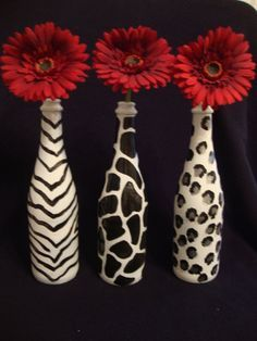 wine bottle craft ideas: not necessarily the animal print but solid colors with the gerber daisies. Definitely not the animal print :( Wine Bottle Art, Wine Bottle Crafts, Wine Bottles, Glass Bottles, Bottle Bottle, Pop Bottles, Cute Crafts, Diy And Crafts, Arts And Crafts