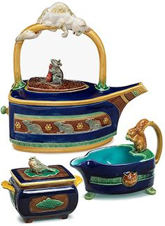 This Minton majolica tea service includes the cat and mouse flat iron teapot, a design attributed to Christopher Dresser, with a registration mark for 1875.